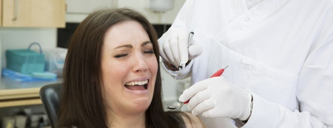 Afraid woman at the dentist